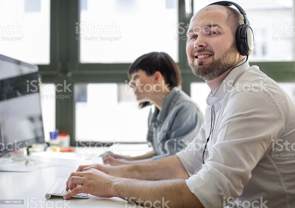 Closeup of Young Businessman working at his desk royalty-free stock photo