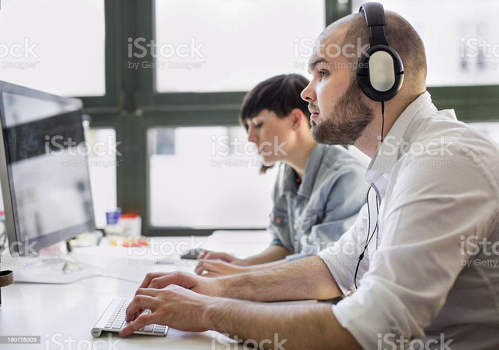 Closeup of Young Businessman working at his desk stock photo