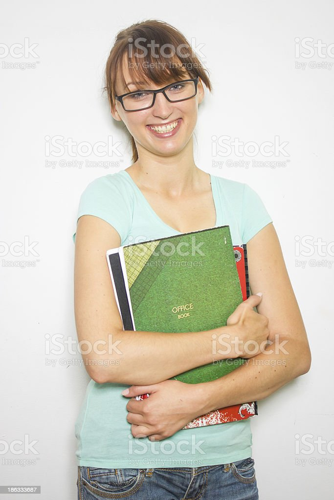 Close-up of young caucasian woman writing on a paper. royalty-free stock photo
