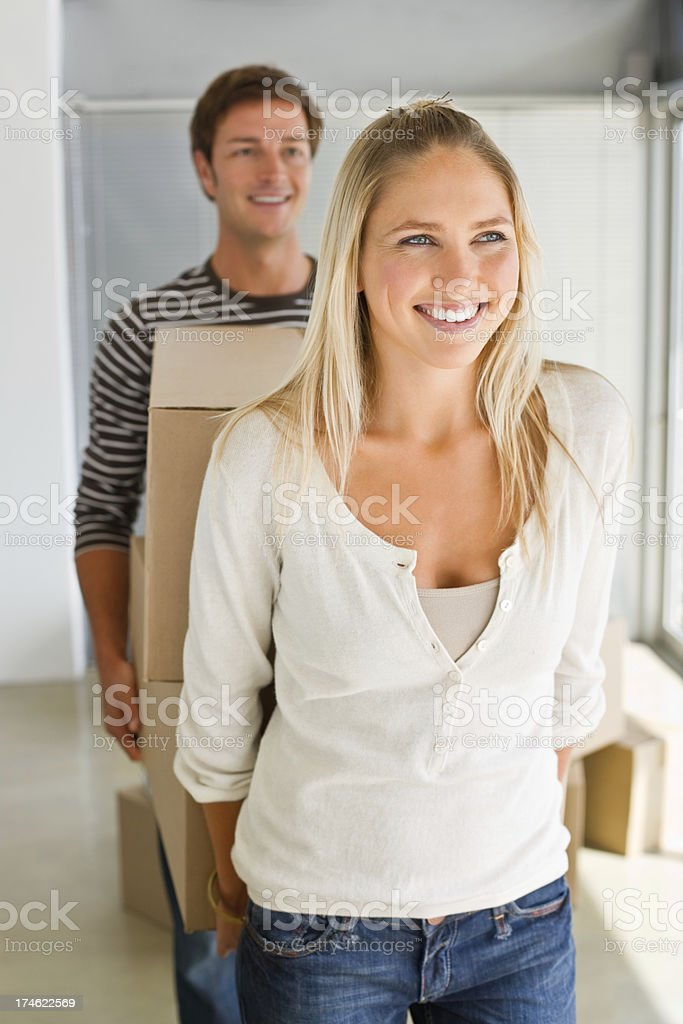 Closeup of young couple carrying boxes royalty-free stock photo