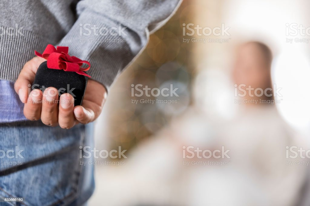 Closeup of young man about to propose stock photo