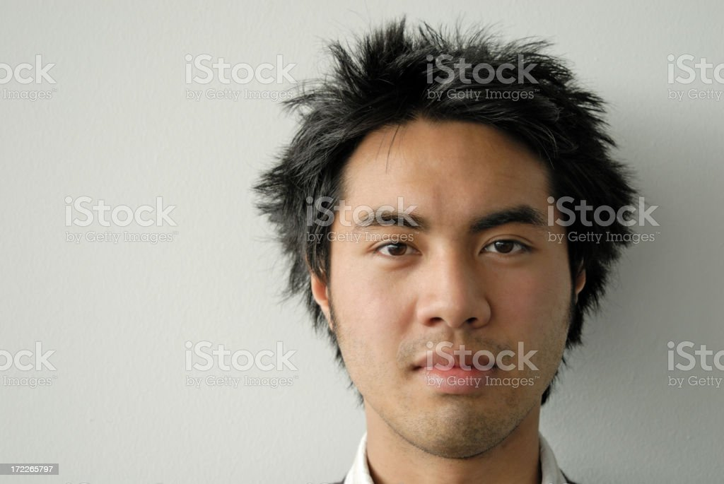 Closeup of young man against white wall royalty-free stock photo