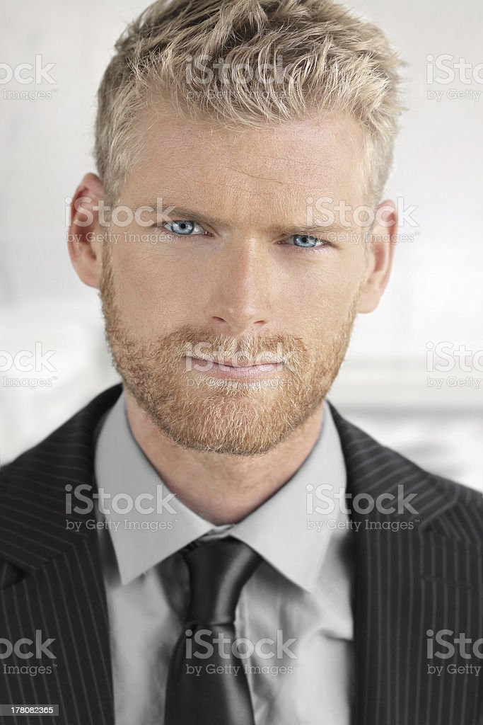 Close-up of young man in suit stock photo