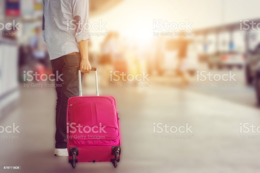 Close-up of young man traveler with baggage suitcases at international airport, travel concept. stock photo