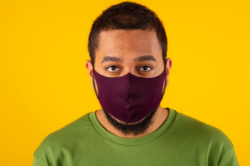 Close-up of young man wearing protective mask during COVID19 outbreak