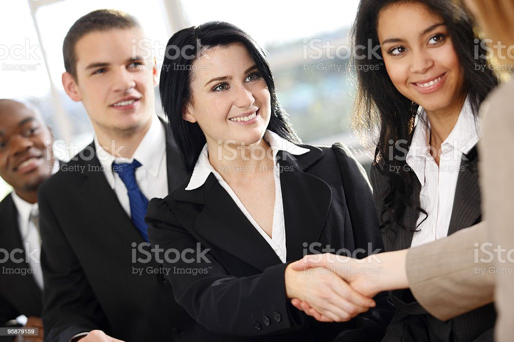 closeup of young multiracial Business team shaking hands on deal royalty-free stock photo