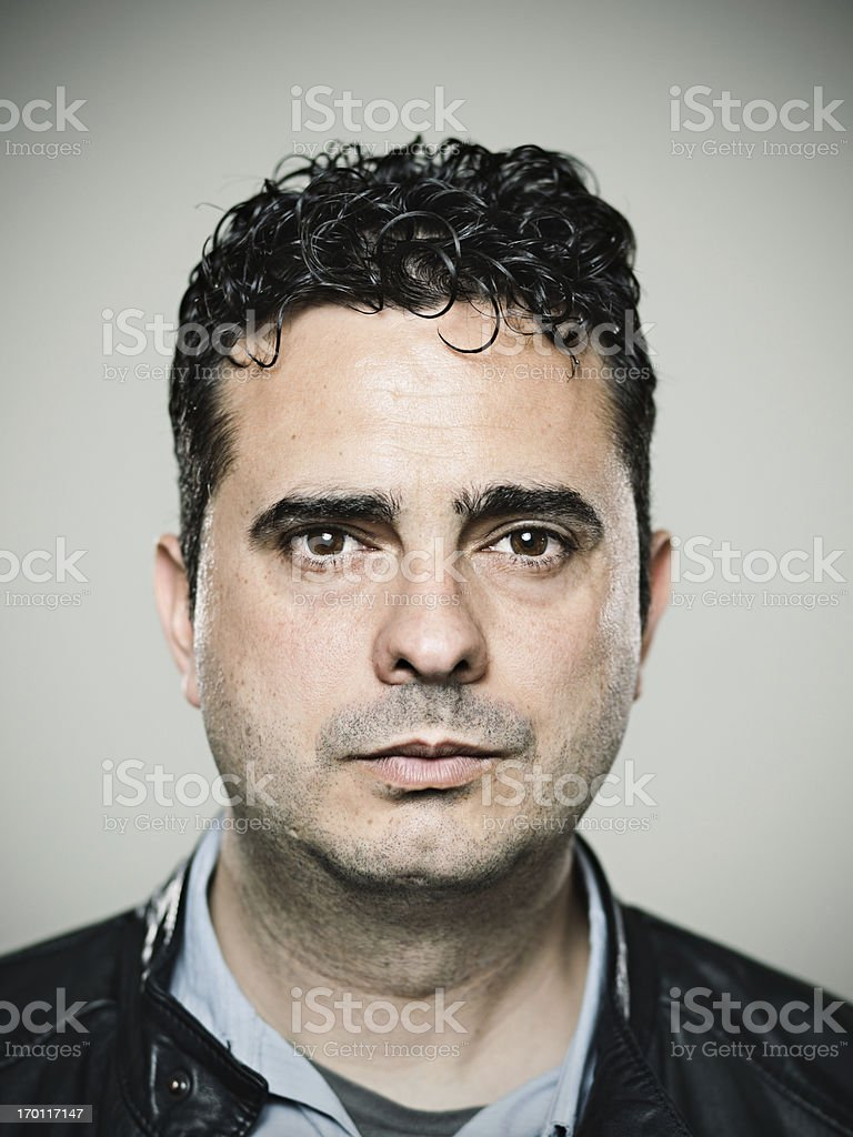 Close-up of young Spanish man in black jacket stock photo