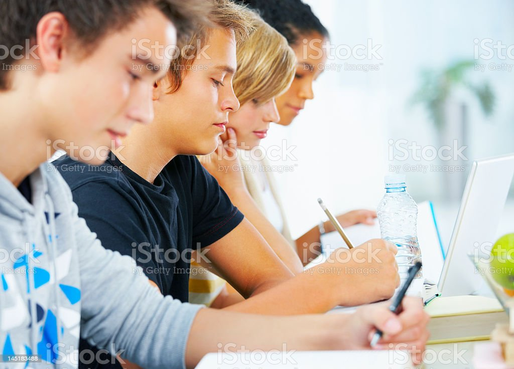 Close-up of young students paying attention royalty-free stock photo