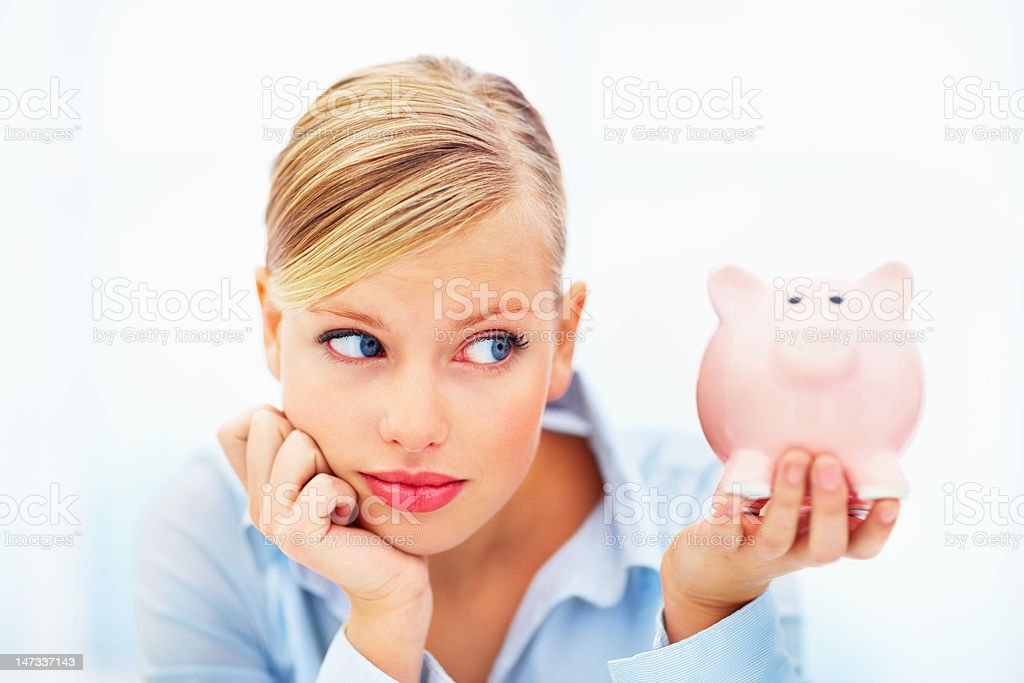 Close-up of young woman holding a piggy bank royalty-free stock photo