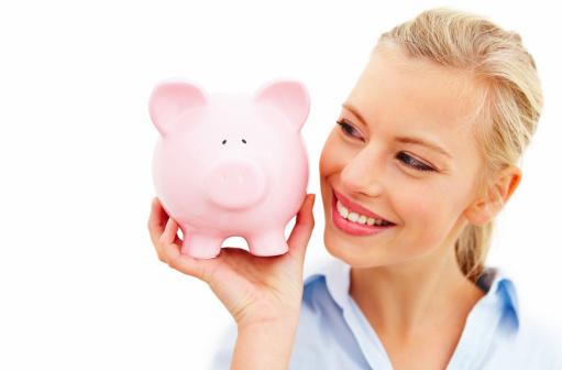 Closeup Of Young Woman Holding Piggy Bank Against White Background Stock Photo - Download Image Now
