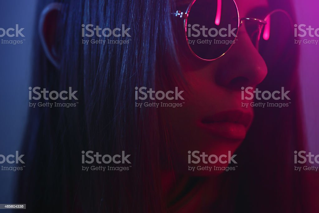 Close-up of young woman in sunglasses. (gel effect) stock photo