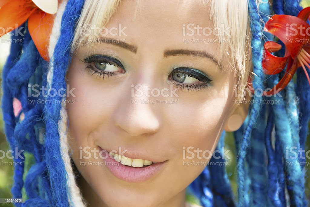 Closeup of young woman looking to side with smile. royalty-free stock photo