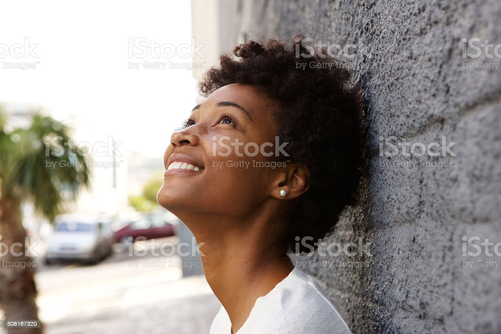 Closeup of young woman looking up stock photo
