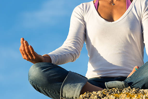 close-up of young woman meditating - carolinemaryan stock pictures, royalty-free photos & images