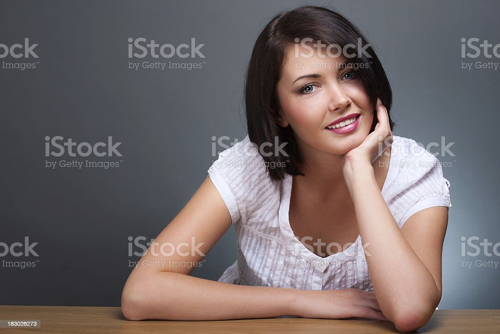 Close-up of young woman over gray background royalty-free stock photo