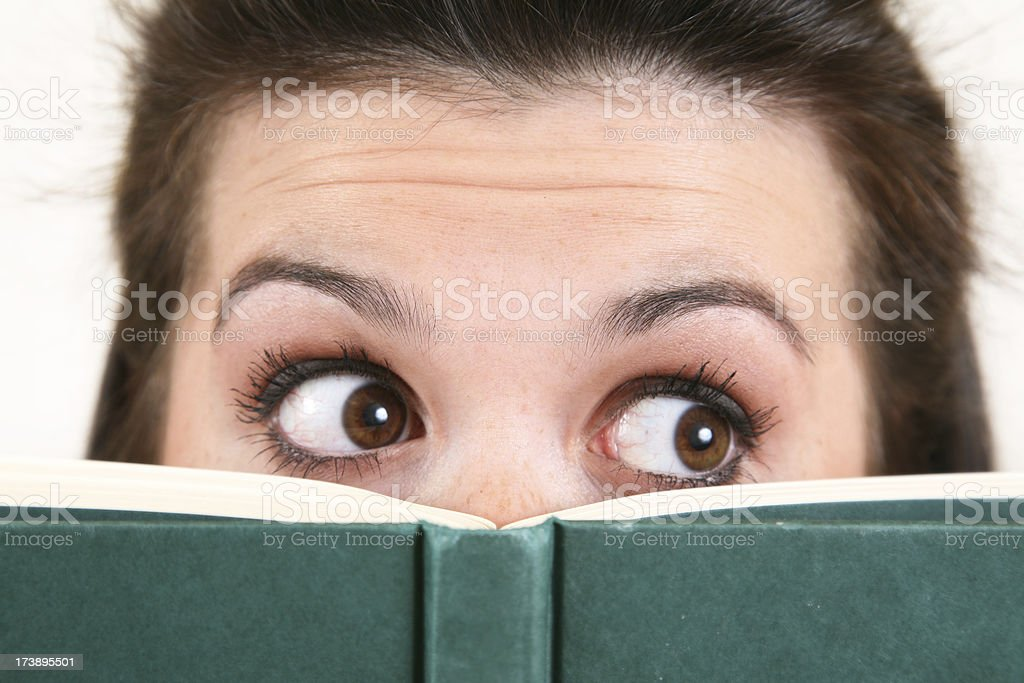 Closeup of Young Woman With Book Looking to Her Left royalty-free stock photo