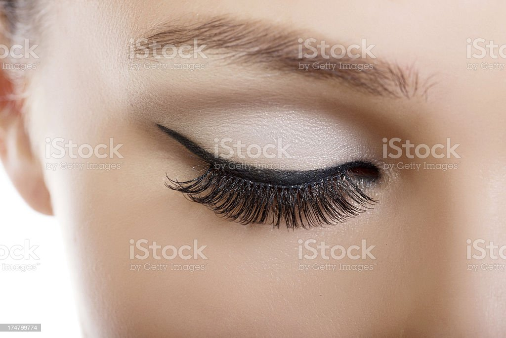 Close-up of young woman's closed eye with makeup stock photo