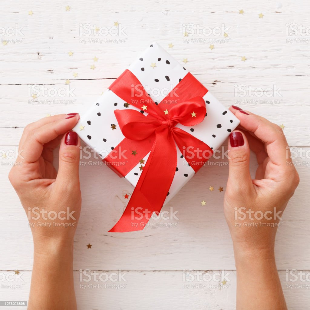 Closeup Of Young Womans Hands Holding Nicely Wrapped Christmas Or