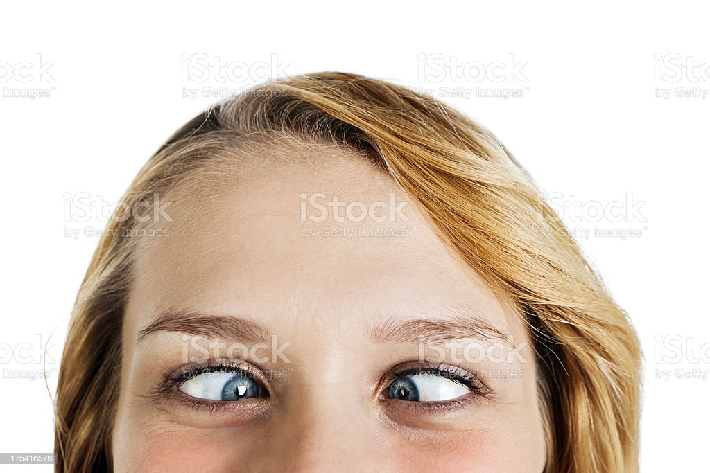 Close-up of zany young blue-eyed blonde squinting at camera stock photo