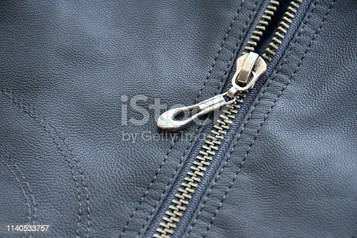 istock Close-up of zipper on leather texture 1140533757