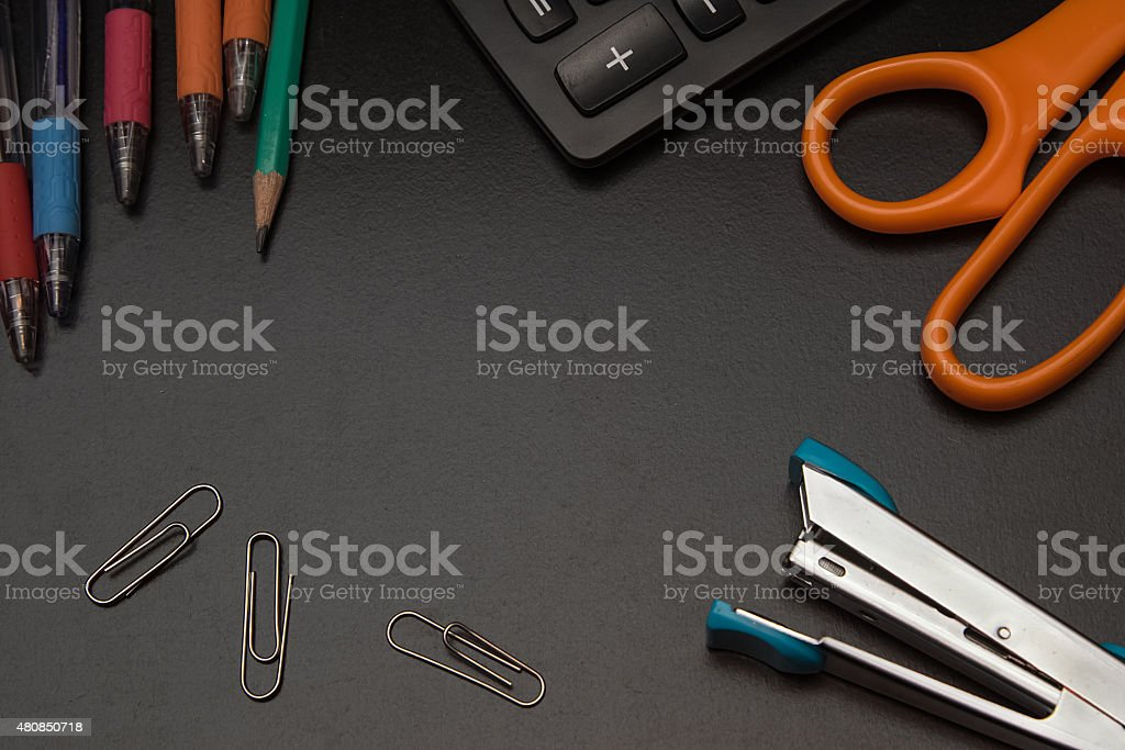 closeup office stationery on black background, back to shcool co stock photo