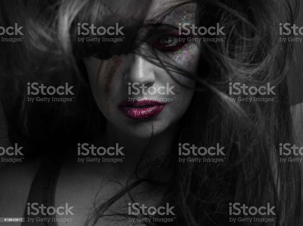 close-up og young woman wearing makeup with tousled hair stock photo