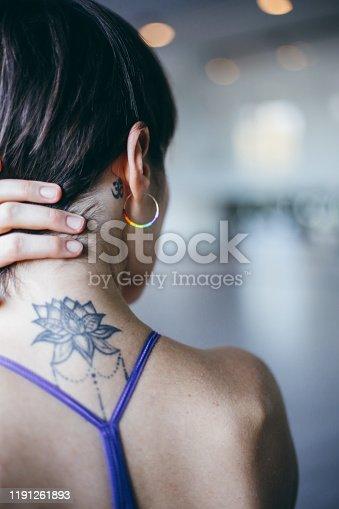 Closeup ohm tattoo