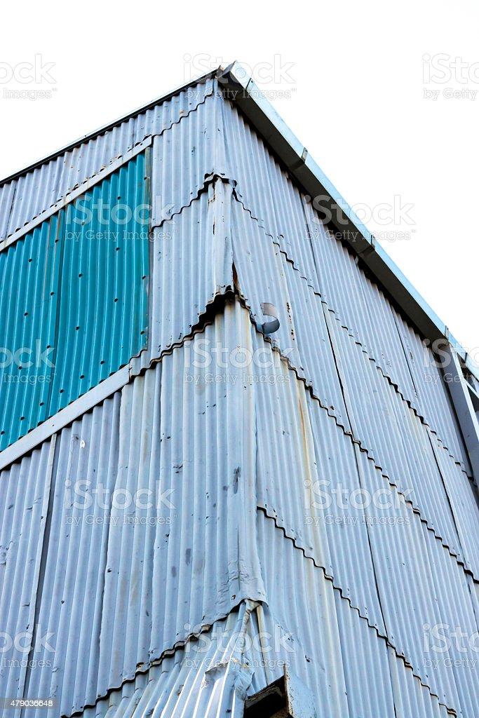 Closeup old abondaned corrugated iron building, copy space stock photo