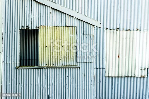 Closeup old corrugated metal shed, background with copy space, horizontal composition