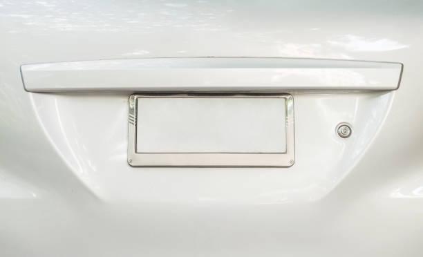 Closeup vieille plaque d'immatriculation à l'arrière de la voiture avec le fond de l'espace texturé - Photo