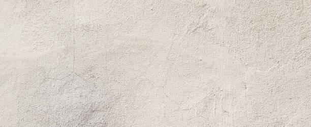 closeup antigua superficie cemento crema brillante textura de fondo simulado para diseño como presentación o concepto de anuncios de banner simple - estuco fotografías e imágenes de stock