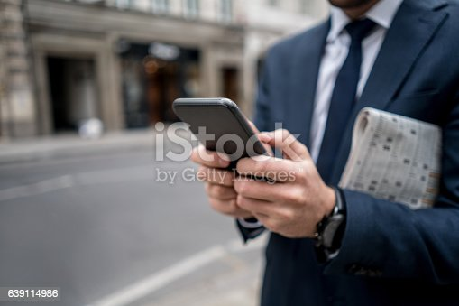 istock Close-up on a business man texting on the phone 639114986