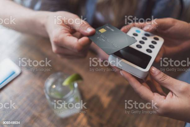 Closeup on a customer making a contactless payment at a restaurant picture id909349534?b=1&k=6&m=909349534&s=612x612&h=lck7lhb4ysoht4ihbpwxhgmwuwssygjemo8fedfzn c=