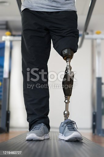istock Close-up on a disabled man wearing a prosthetic and doing physical therapy 1219460727