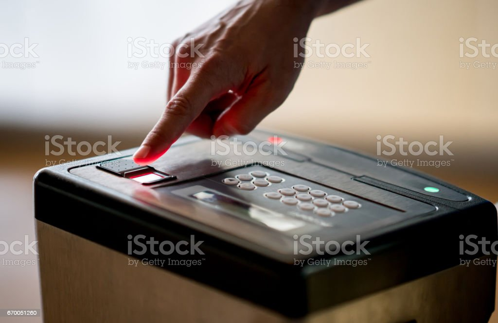 Close-up on a fingerprint scan to get access to a place stock photo
