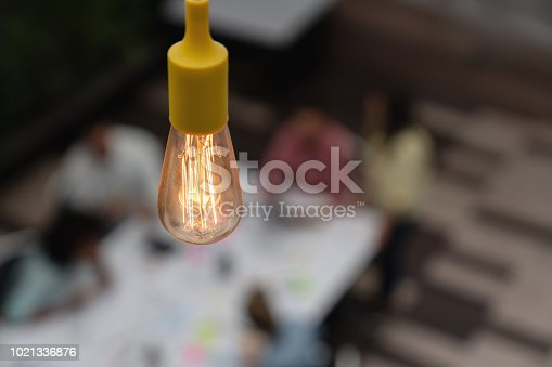 istock Close-up on a lightbulb at a creative office 1021336876