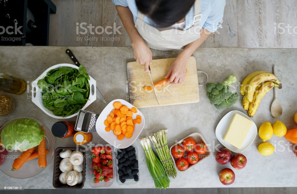 Close-up on a woman cooking at home stock photo
