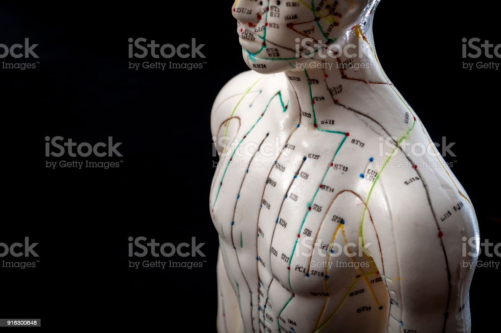 Closeup on acupuncture male model with copyspace on black background stock photo
