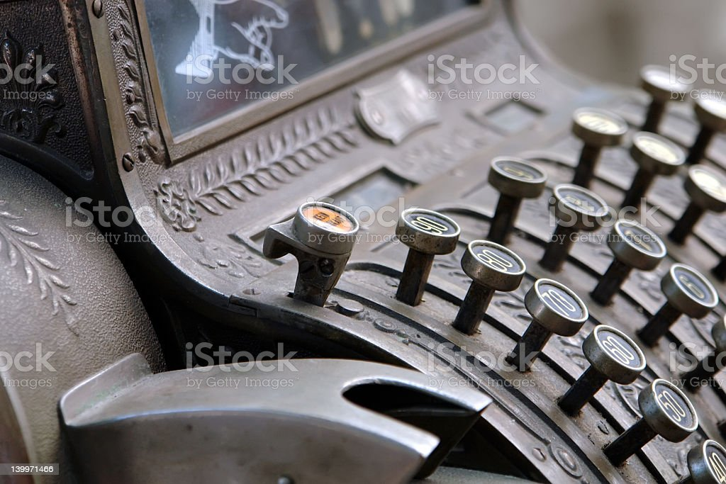 A close-up on an old fashion cash register stock photo