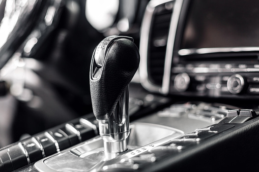 Closeup On Automatic Transmission Lever In Modern Car Multimedia And Navigation Control Buttons Car Interior Details Transmission Shift Stock Photo - Download Image Now