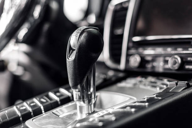 Close-up on automatic transmission lever in modern car. multimedia and navigation control buttons. Car interior details. Transmission shift. stock photo