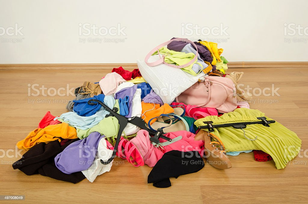 Closeup on big pile of clothes thrown to the ground. stock photo