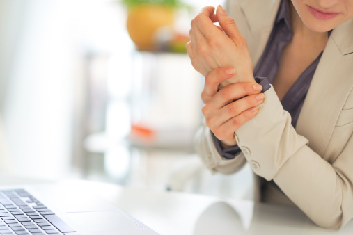 istock closeup on business woman with wrist pain 492150571
