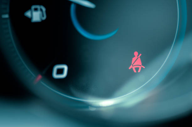 Close-up on car dashboard and warning safety belt light icon stock photo