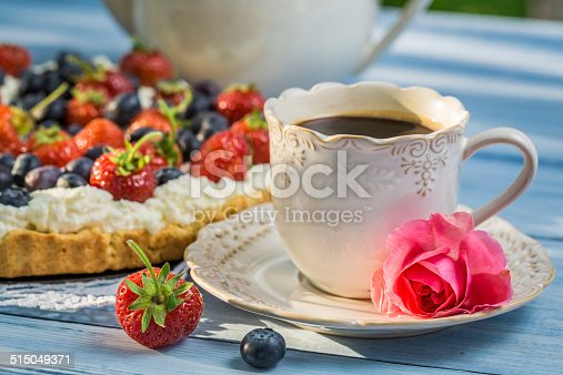 502634476 istock photo Close-up on coffee and tart with strawberries and blueberries 515049371