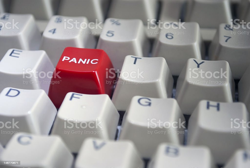 Close-up on Computer Keyboard with Red Panic button key stock photo