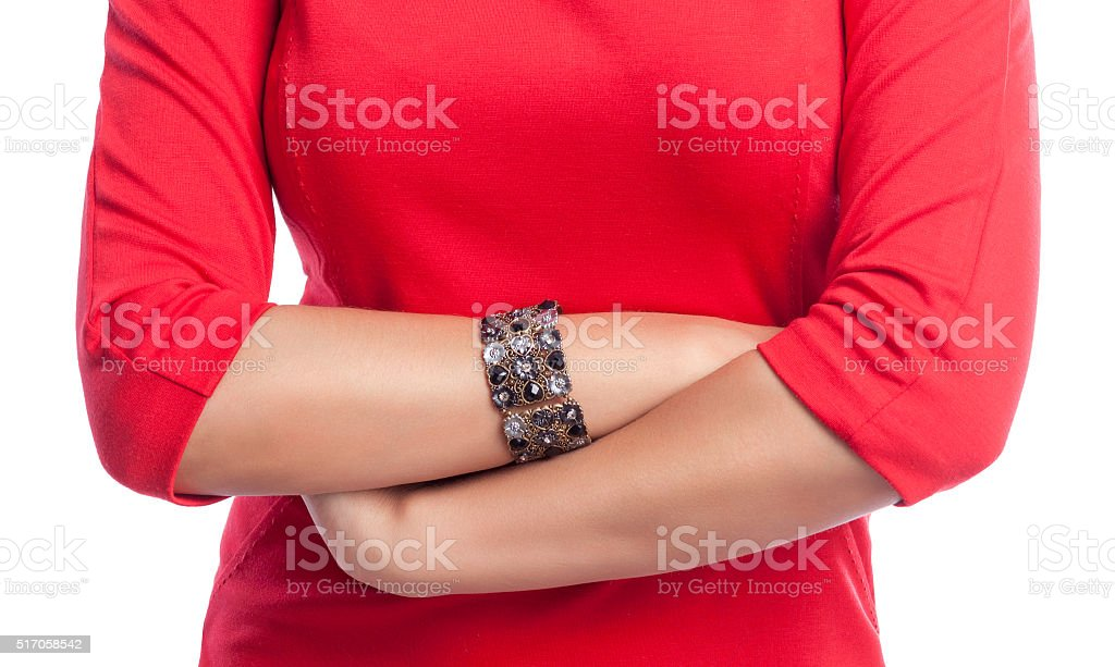 Closeup on crossed hands of business woman stock photo