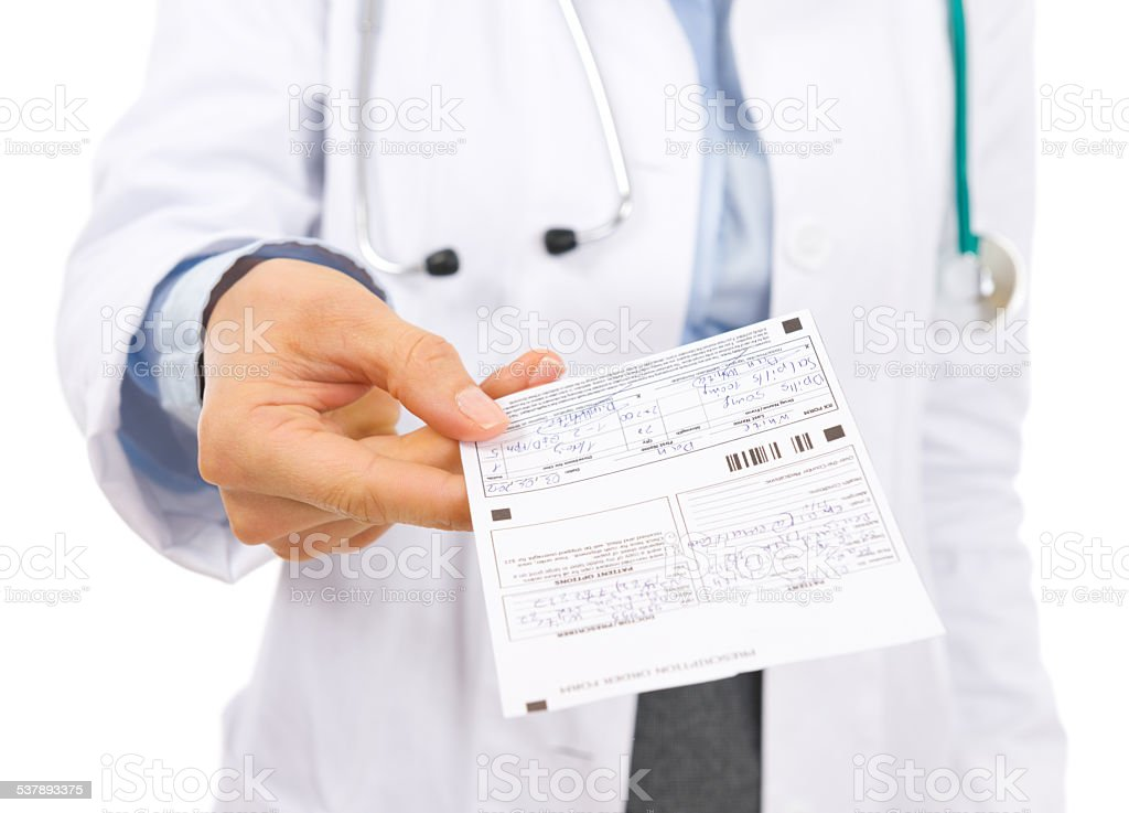 closeup on doctor woman giving prescription stock photo