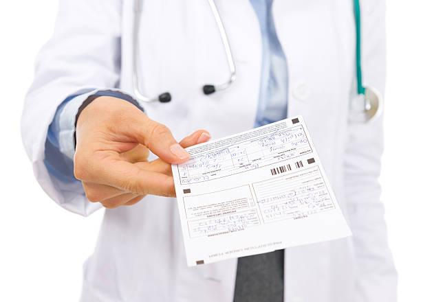 closeup on doctor woman giving prescription stock photo