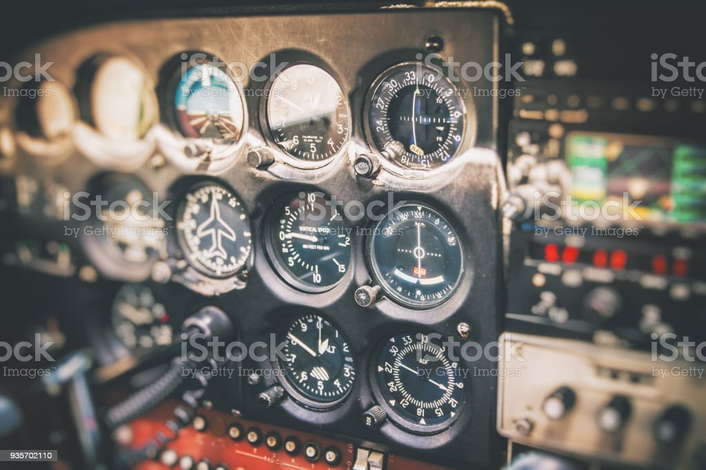 Close-up on flight instruments in old small airplane cockpit interior control panel in selective focus stock photo